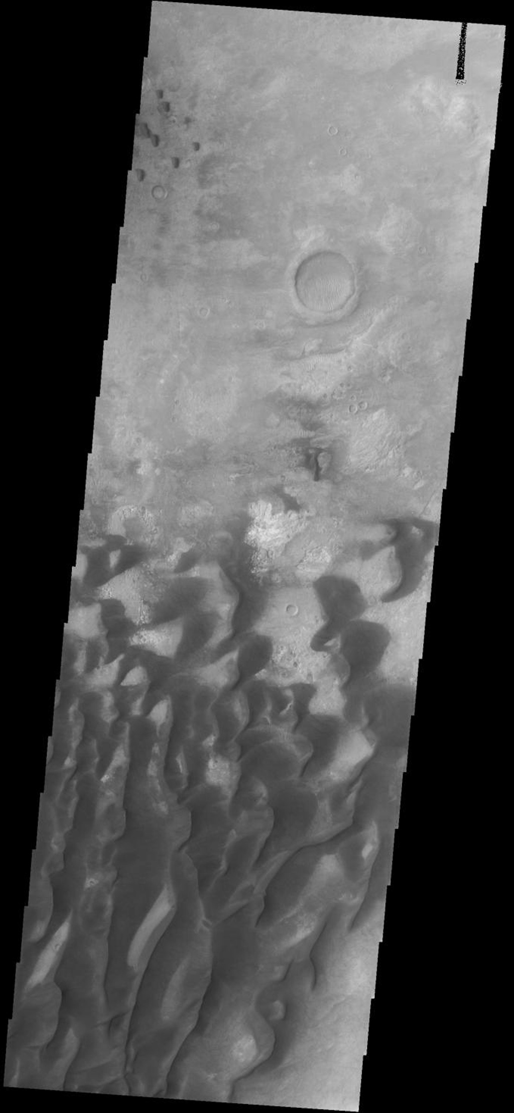 These sand dunes are located on the floor of Kaiser Crater on Mars as seen by NASA's 2001 Mars Odyssey spacecraft.