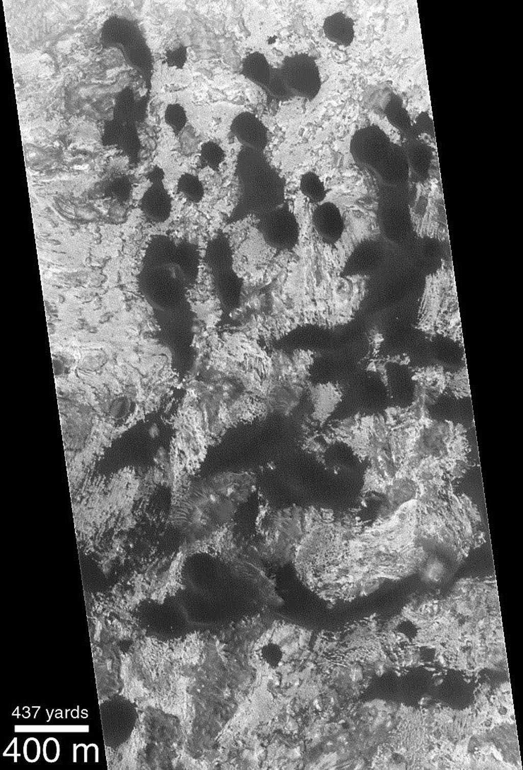 NASA's Mars Global Surveyor shows classic, crescentic shape of the dark barchan dunes on Mars.