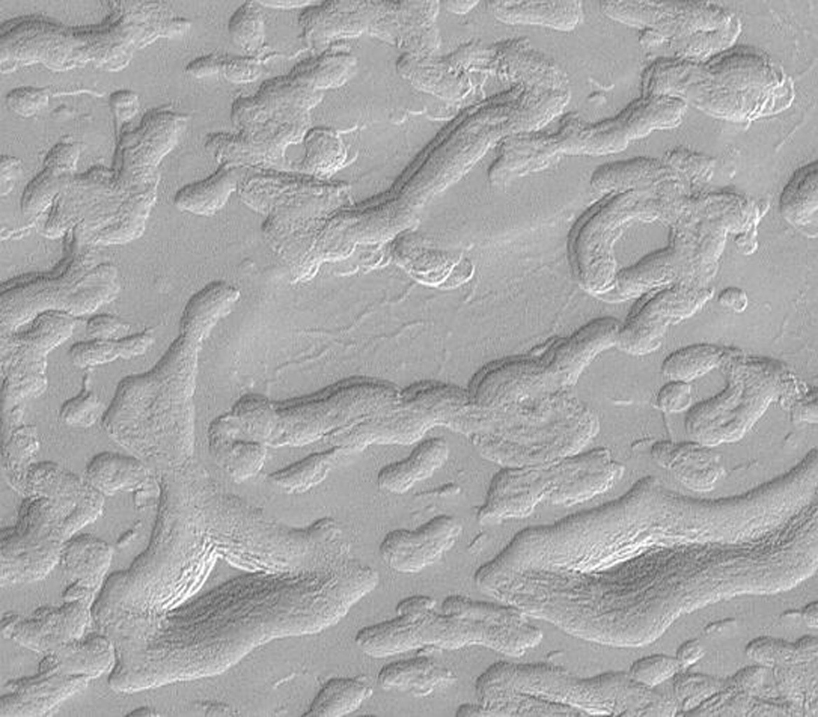 NASA's Mars Global Surveyor shows aprons that surround mesas and buttes of remnant layers on Mars' south polar cap such as two almost triangular features featuring a stair-stepped pattern that suggest these hills are layered.