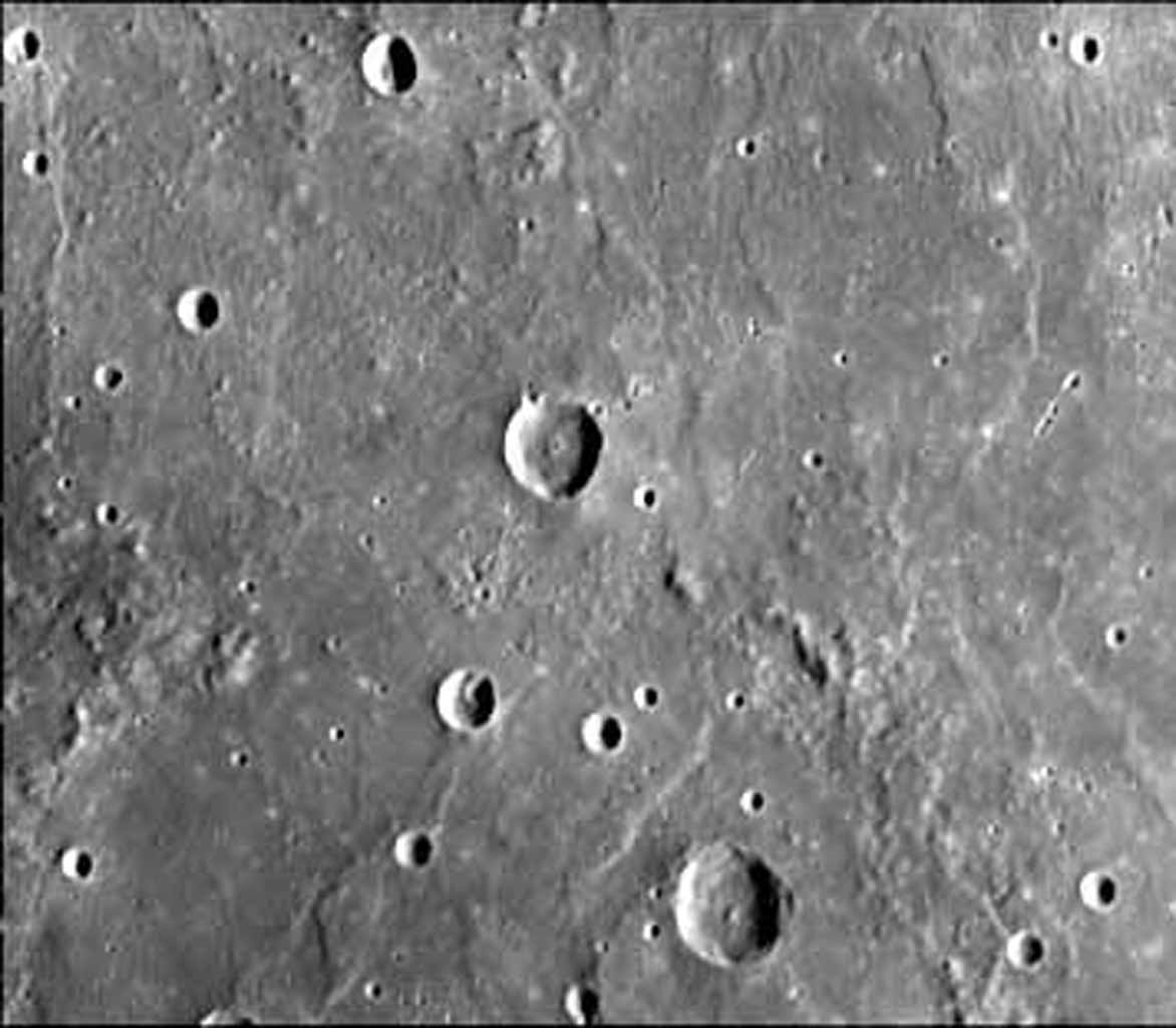 This image, from NASA's Mariner 10 spacecraft which launched in 1974, is located about 500 km east of the Caloris basin and shows hummocky plains interpreted as Caloris ejecta in the upper half of the picture and smooth plains in the lower half.