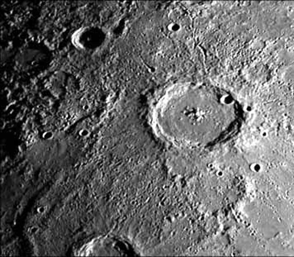 This image, from NASA's Mariner 10 spacecraft which launched in 1974, features a 140 kilometer diameter crater and its surrounding zone of secondary craters. T