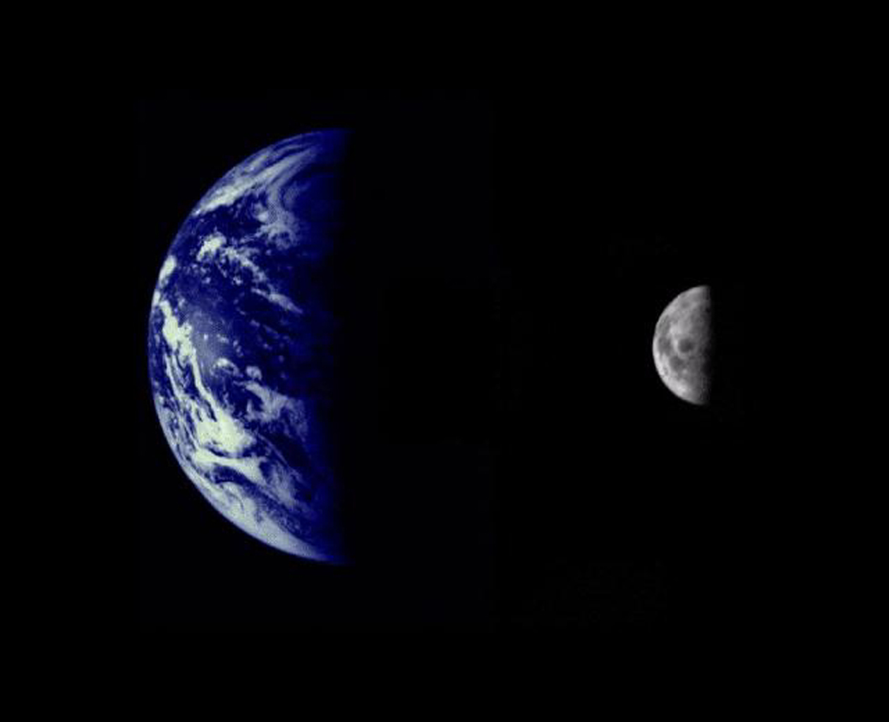 The Earth and Moon were imaged by NASA's Mariner 10, launched on November 3, 1973, from 2.6 million km while completing the first ever Earth-Moon encounter by a spacecraft capable of returning high resolution digital color image data.
