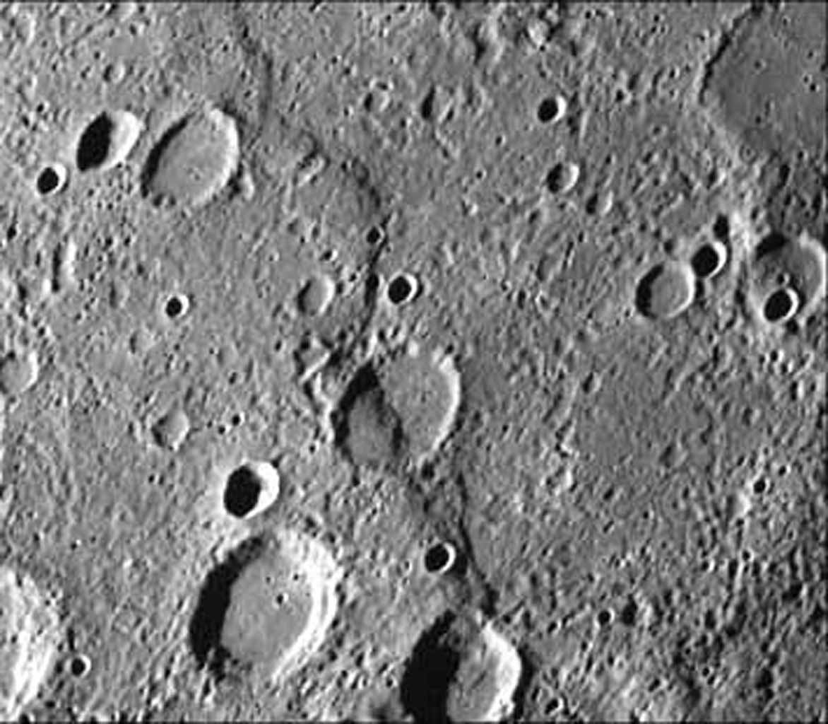 Intercrater plains and heavily cratered terrain typical of much of Mercury outside the area affected by the formation of the Caloris basin are shown in this image taken during the NASA's Mariner 10's first encounter with Mercury in 1974.