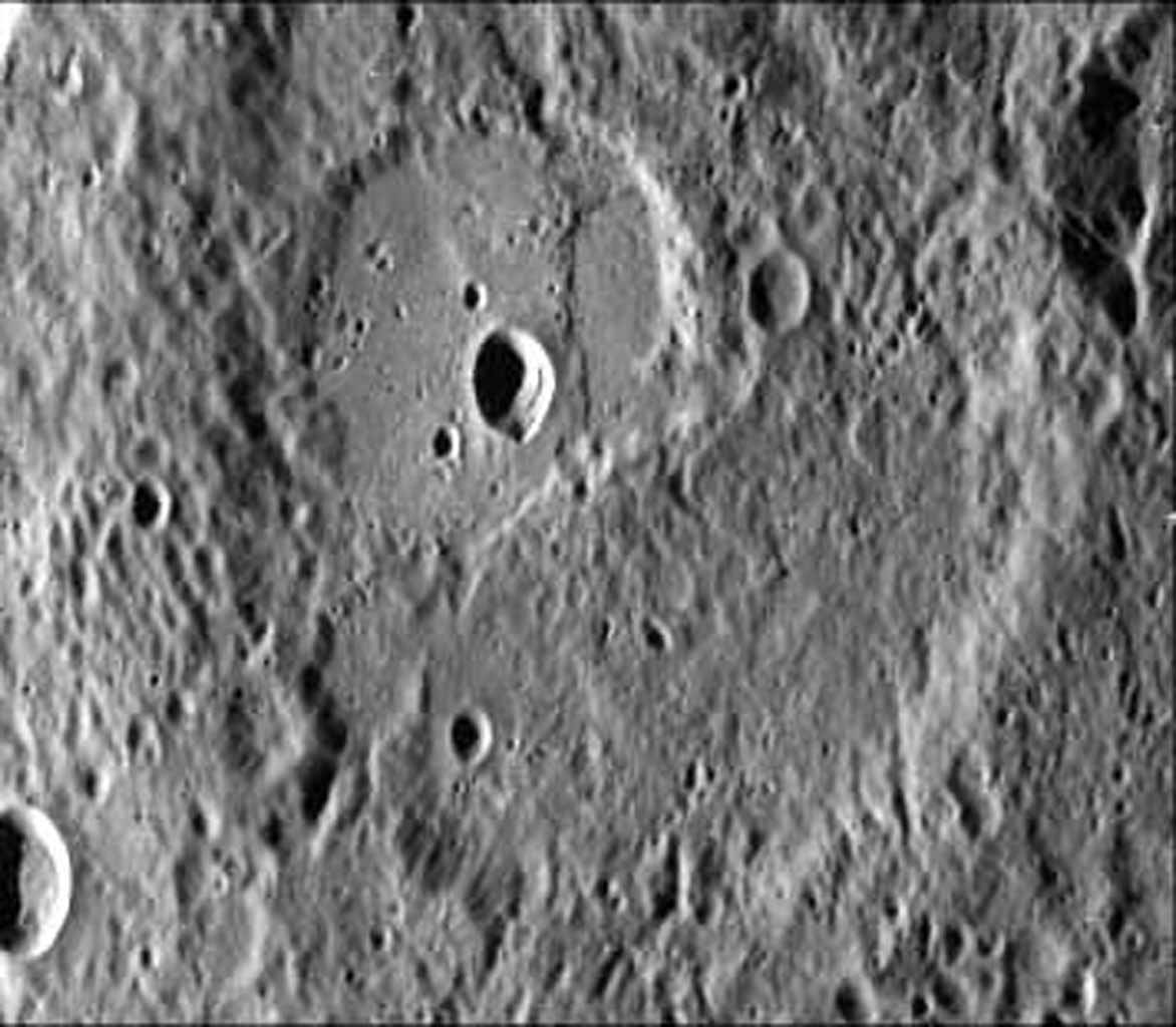 This image was taken by NASA's Mariner 10 during it's first encounter with Mercury in 1974. The scarp forms a broad lobe whose southern end abuts against and follows closely the irregular contour of the crater wall.
