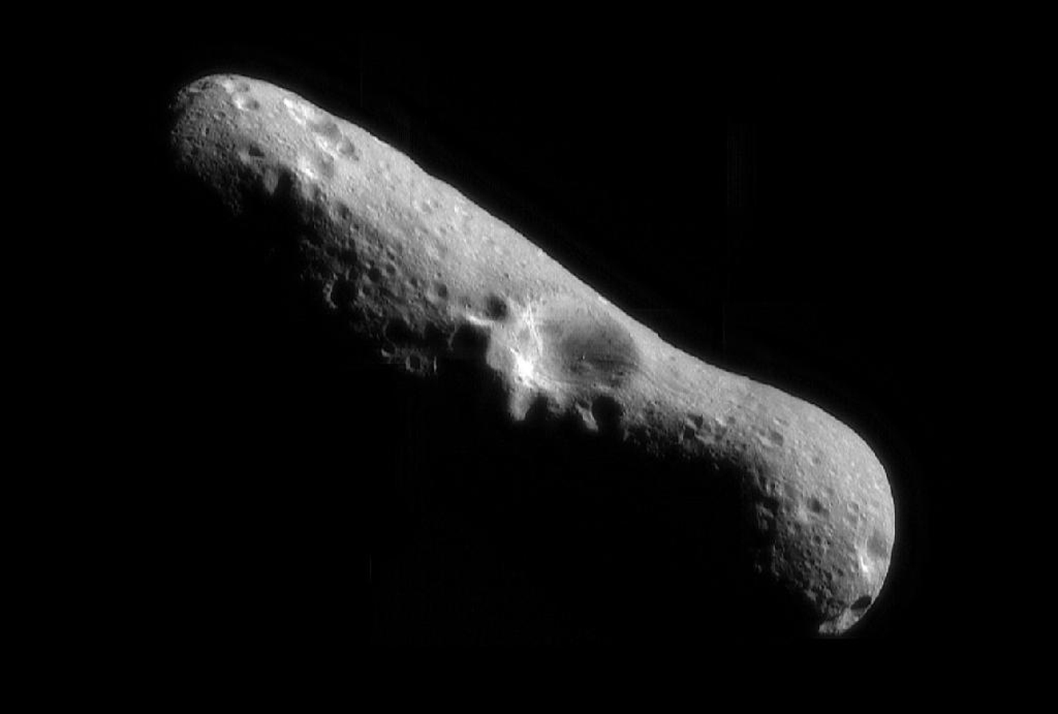 This image of Eros, looking down over the north pole at one of its largest craters, was the first of an asteroid taken from an orbiting spacecraft, obtained by NASA's NEAR Shoemaker on Feb 14, 2000, immediately after the spacecraft's insertion into orbit.