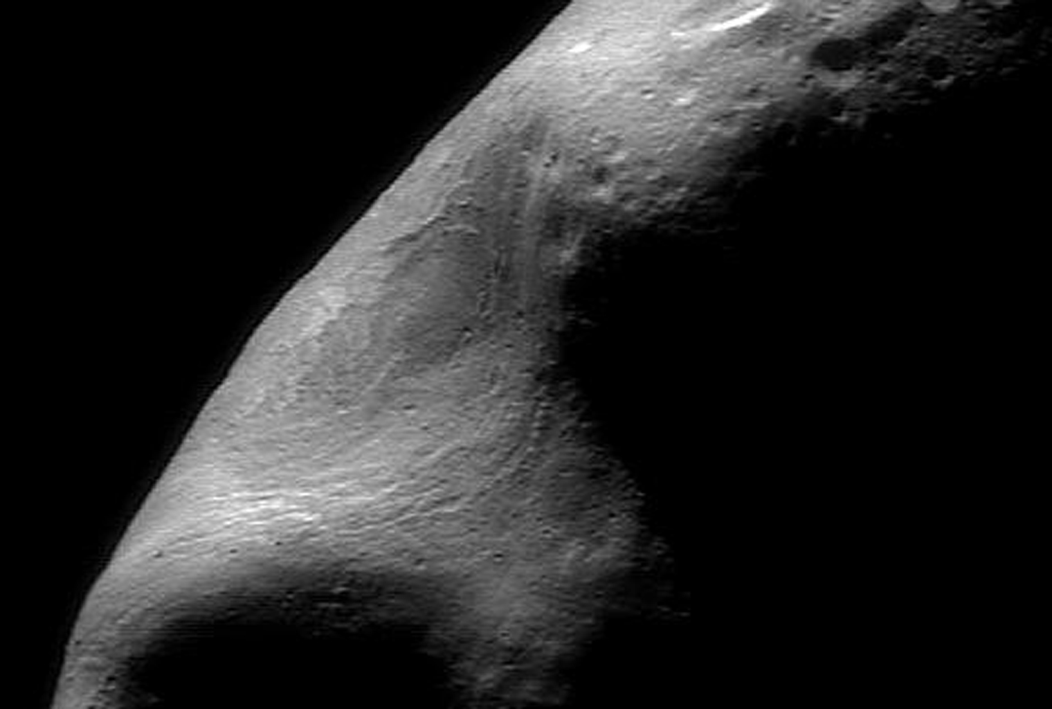 This picture was taken from NASA's NEAR Shoemaker spacecraft on Feb 15, 2000, while the spacecraft was passing directly over the large gouge that creates Eros's characteristic peanut shape.