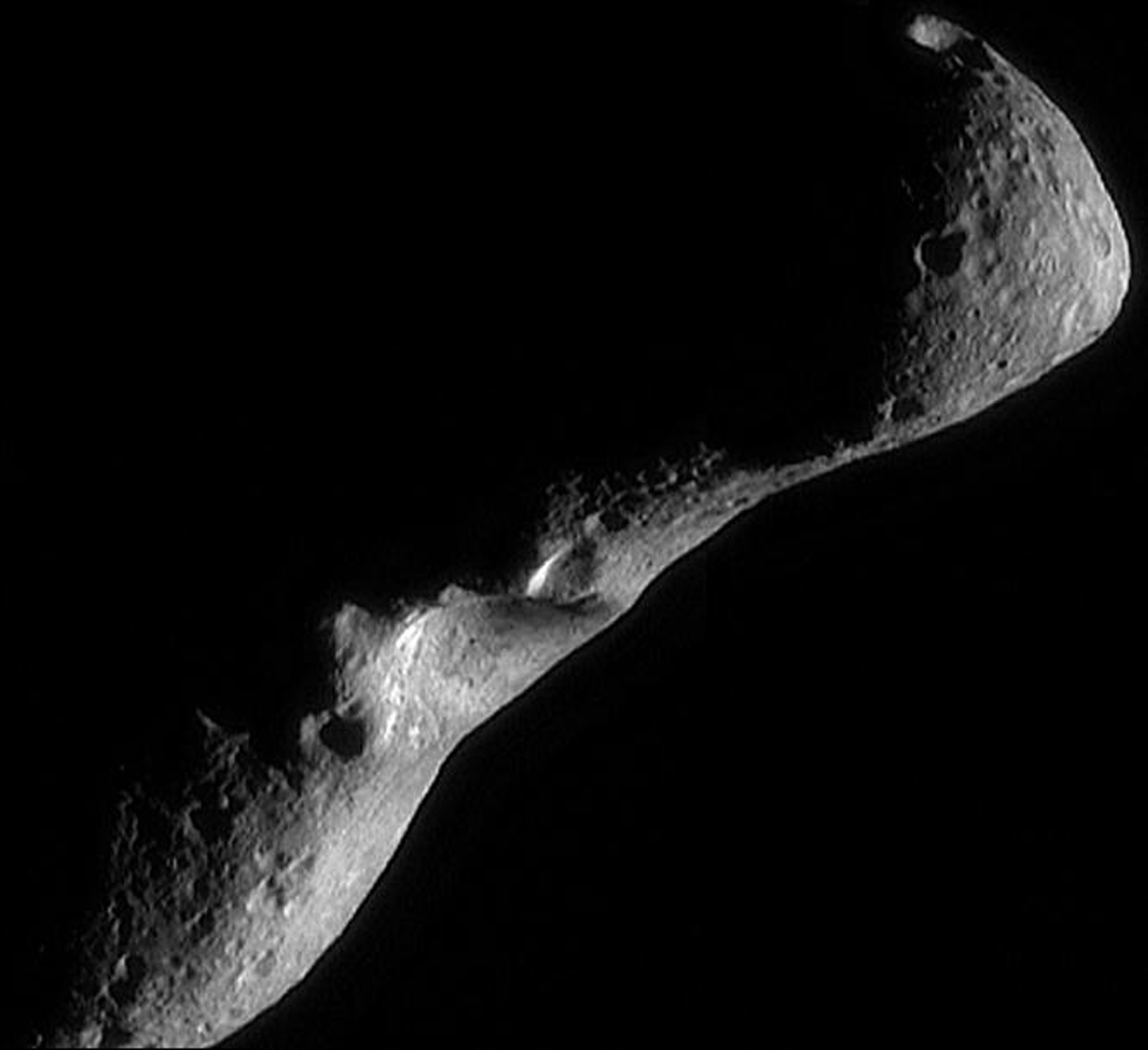 This image was taken by NASA's NEAR Shoemaker spacecraft on Feb 18, 2000 as it flew over the shadowed southern hemisphere, looking north at a crescent asteroid Eros.