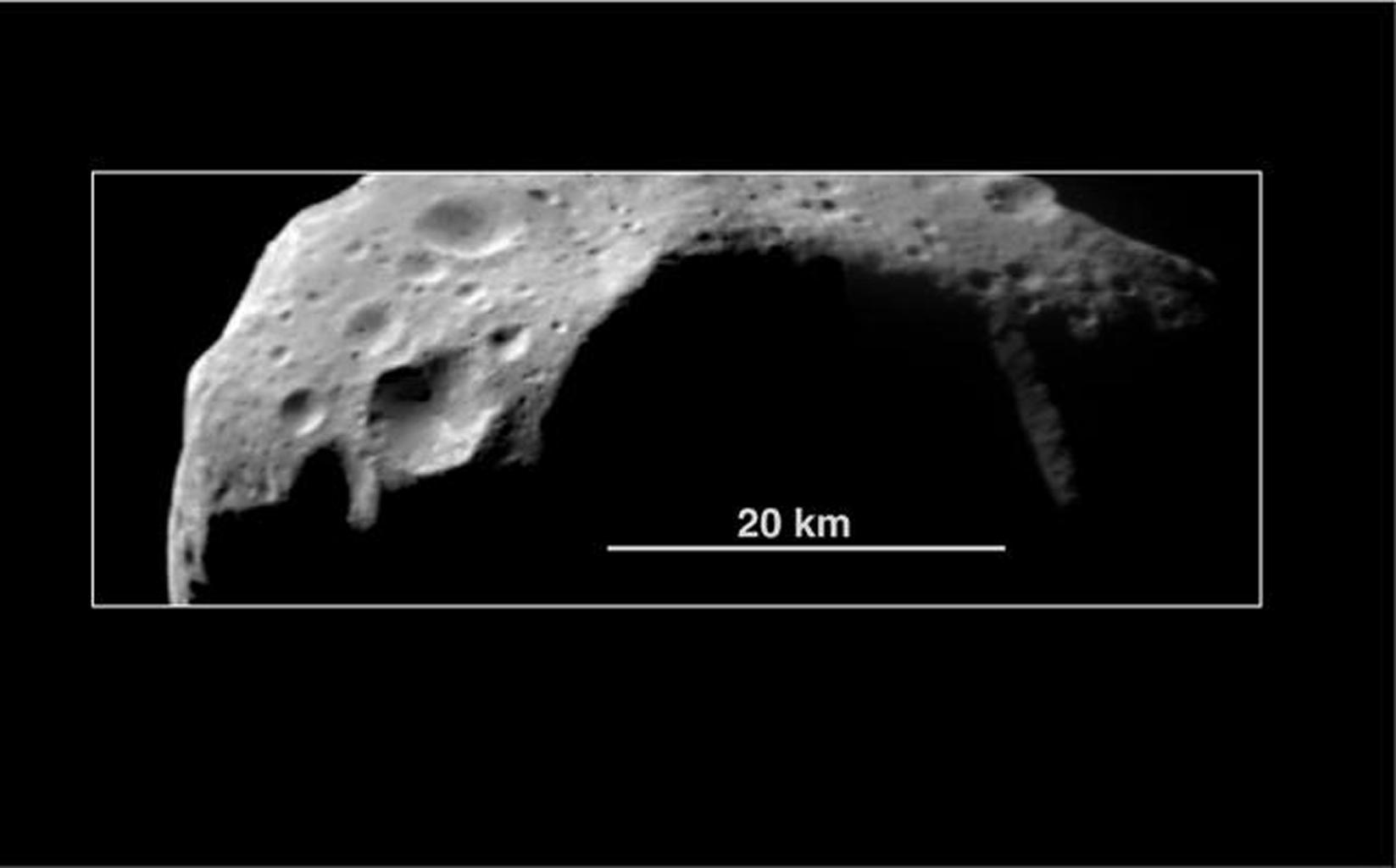 This image of asteroid 253 Mathilde was returned by NASA's NEAR Shoemaker spacecraft in 1997. Raised crater rims suggest that some of the material ejected from these craters traveled only short distances before falling back to the surface.