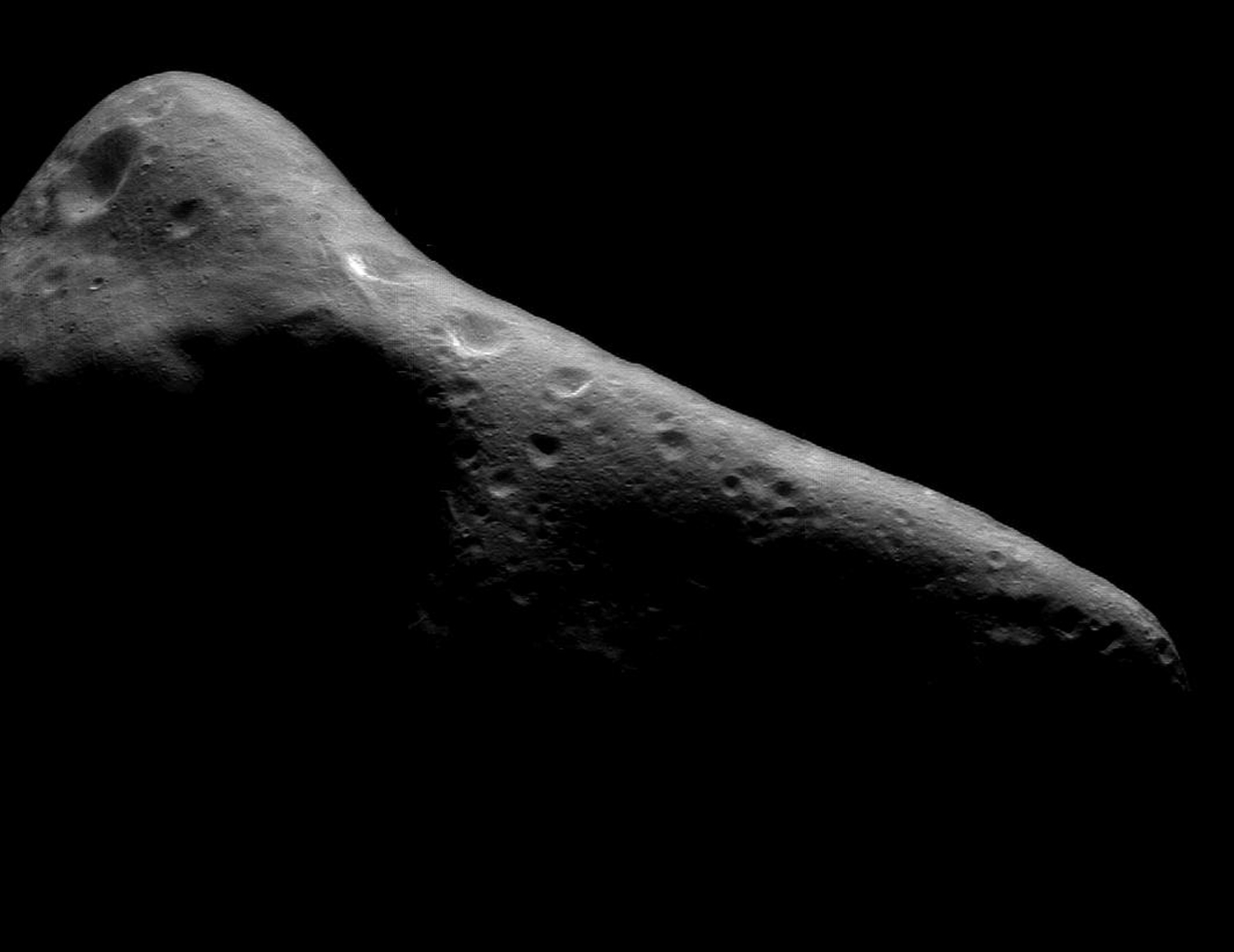 This image of asteroid Eros was taken by NASA's NEAR Shoemaker on Feb 29, 2000. Many parts of the asteroid have 'grooves,' linear troughs about 330 feet wide and several miles long.