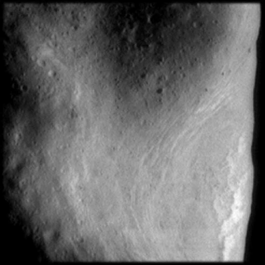 This image from NASA's NEAR Shoemaker shows the northeast rim of the saddle region on Eros. Bright sinuous features associated with a ridge are evident as are parallel, closely spaced grooves in the floor of the saddle.