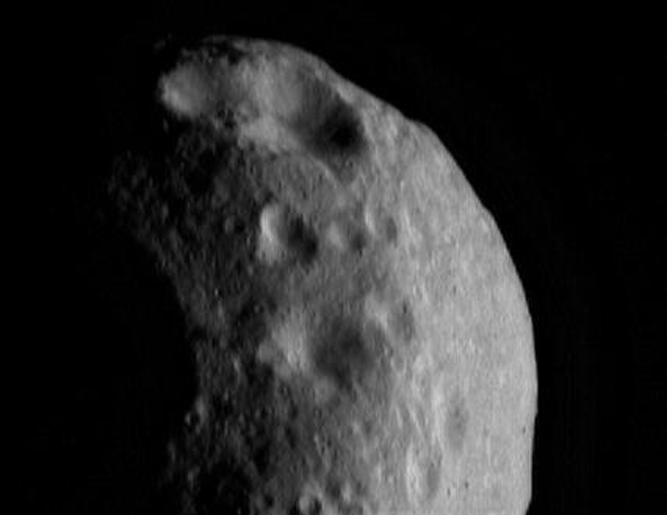 This image of asteroid Eros, taken by NASA's NEAR Shoemaker on March 6, 2000, shows craters with a variety of shapes and sizes.