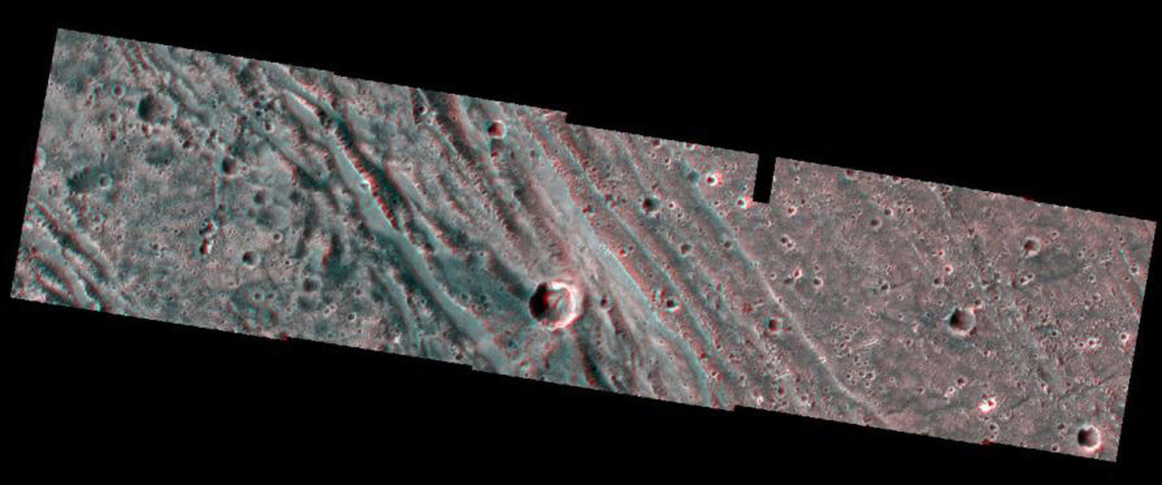 The boundary between the bright terrain of Harpagia Sulcus and dark terrain of Nicholson Regio areas of Jupiter's moon Ganymede springs out when viewed through red/blue 3-D glasses, in this image taken by NASA's Galileo spacecraft as it flew by Ganymede.