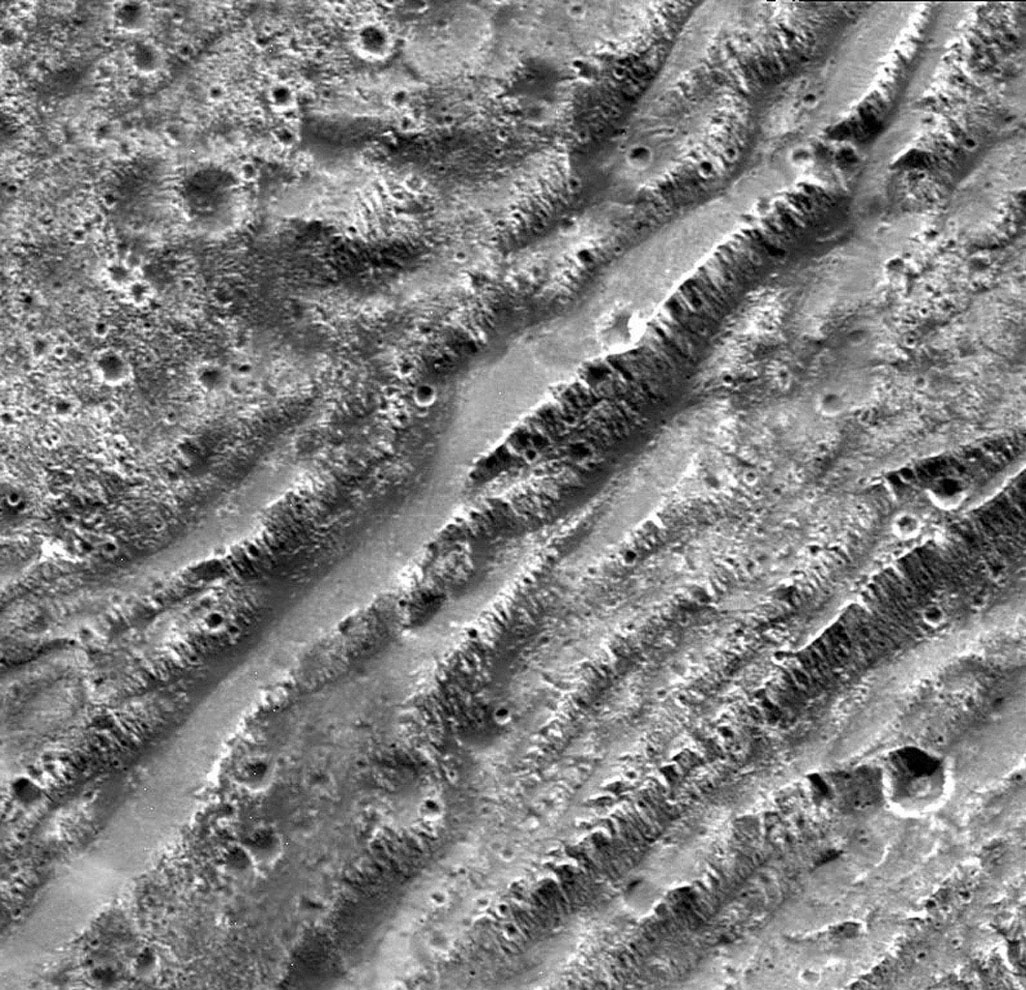 NASA's Galileo spacecraft took this image of dark terrain within Nicholson Regio, near the border with Harpagia Sulcus on Jupiter's moon Ganymede. The ancient, heavily cratered dark terrain is faulted by a series of scarps.
