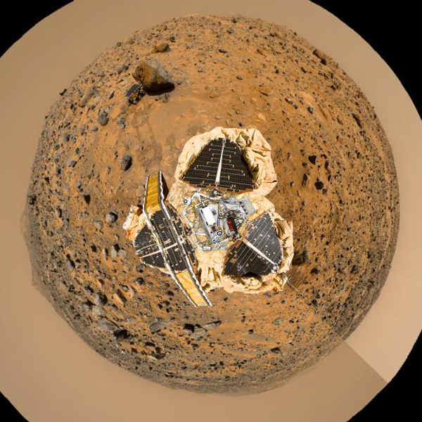 This image from NASA's Mars Pathfinder has been rotated so that the main points of interest, which are the 'Rock Garden,' the rover Sojourner and the rock 'Yogi,' are visible arching across the upper hemisphere.