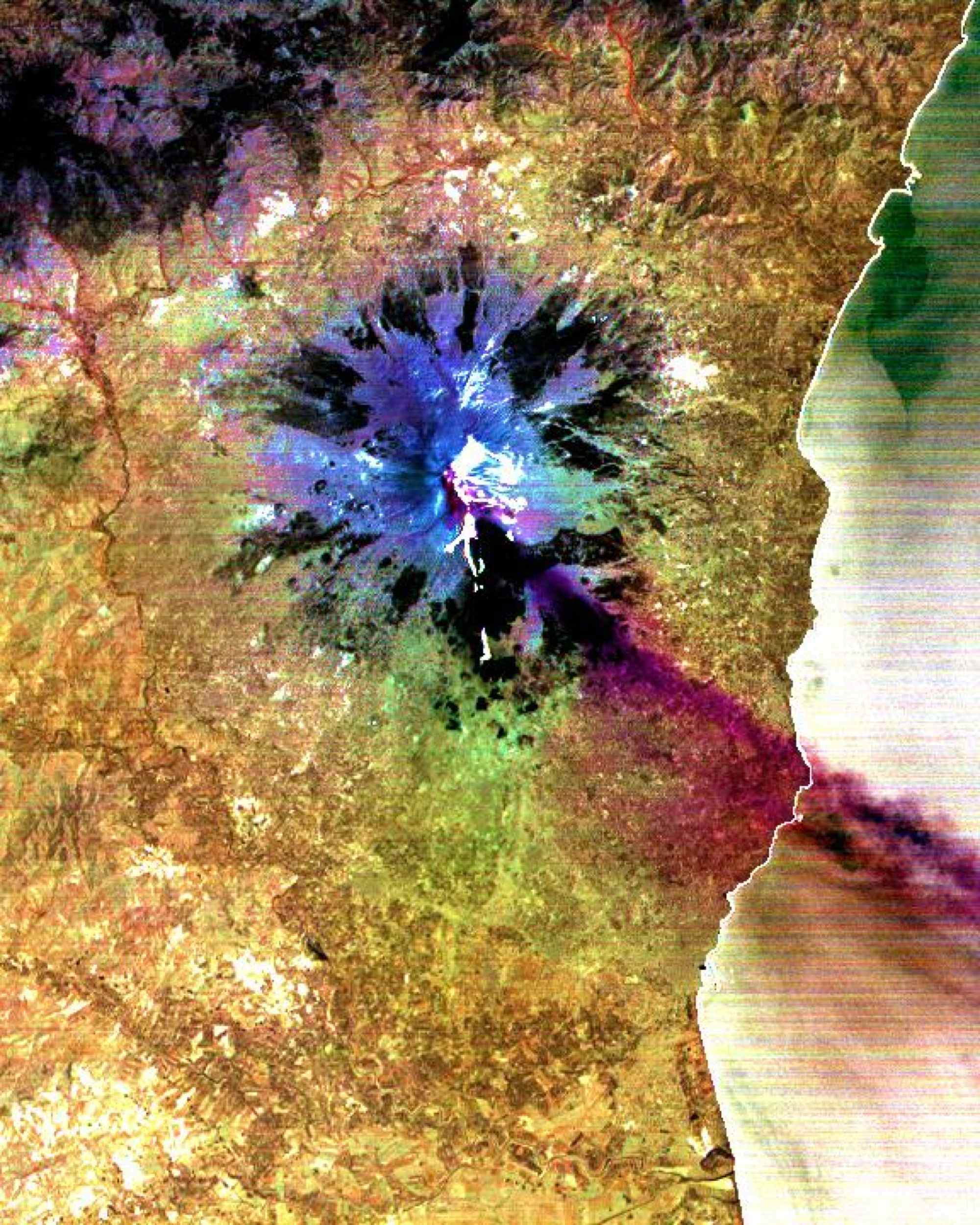 This image was acquired by NASA's Terra satellite on July 29, 2001 and shows a sulfur dioxide plume (in purple) drifting over the city of Catania.