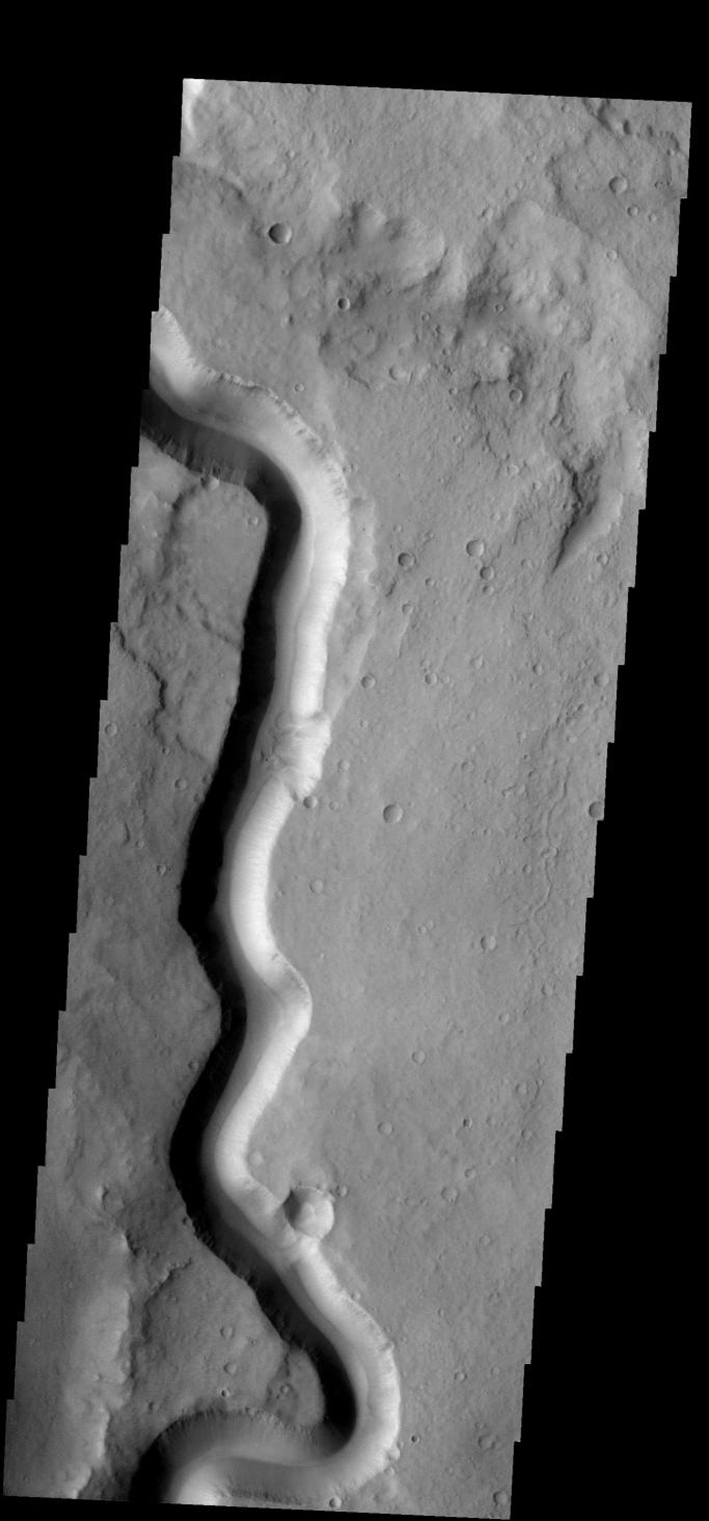 In this section of Tinto Vallis on Mars there are no tributary stream channels joining the main channel. This tells us that whatever carved the channel originated in some other region as seen by NASA's 2001 Mars Odyssey.