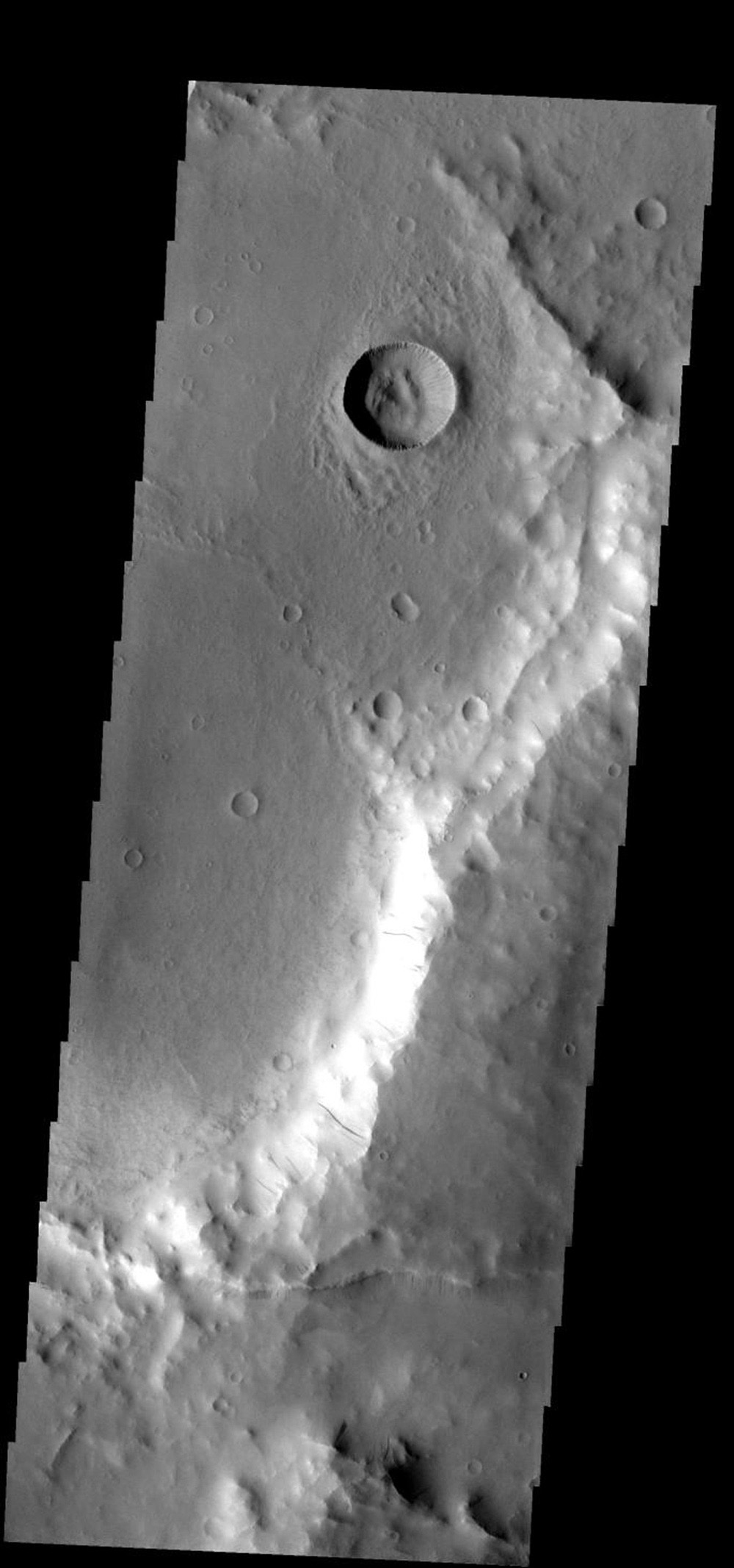 These dust avalanches occur in a crater within Iani Chaos on Mars as seen by NASA's 2001 Mars Odyssey spacecraft.