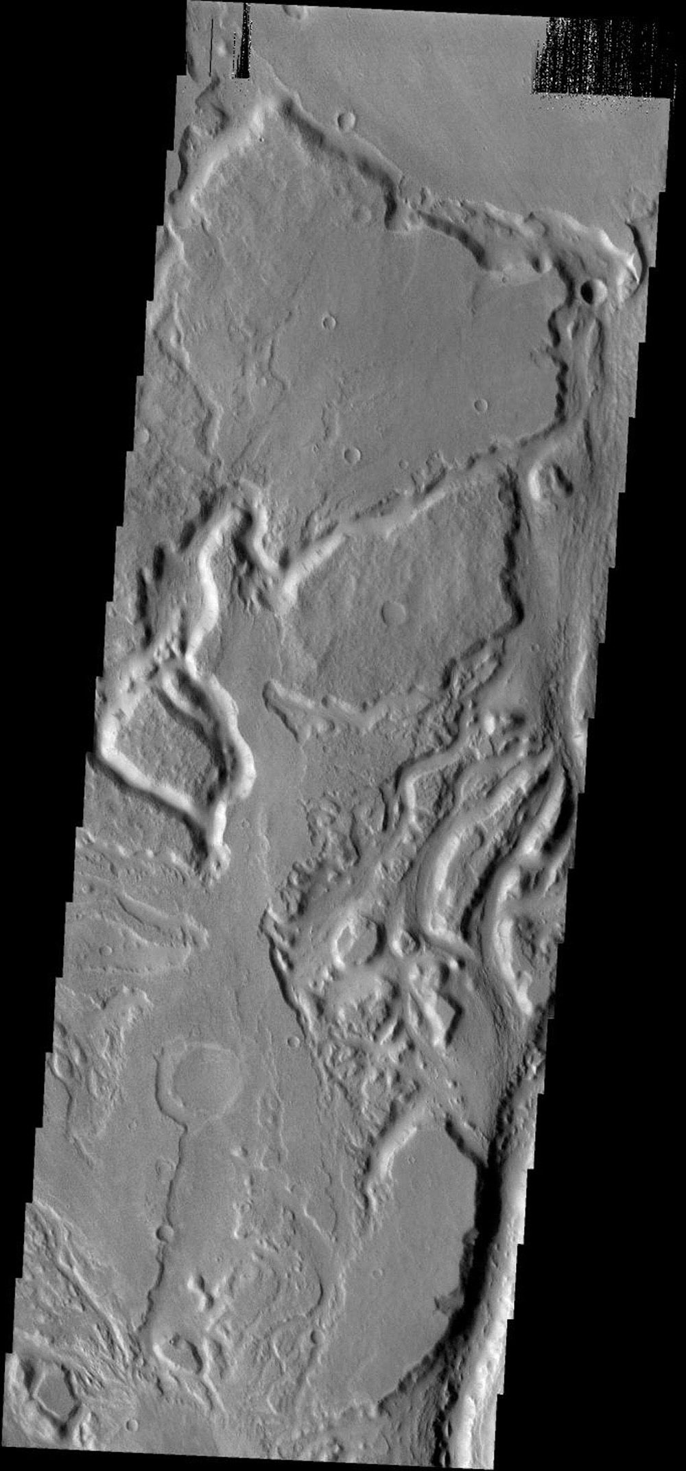 The many small channels in this image are part of the larger Sabis Vallis on Mars as seen by NASA's 2001 Mars Odyssey spacecraft.