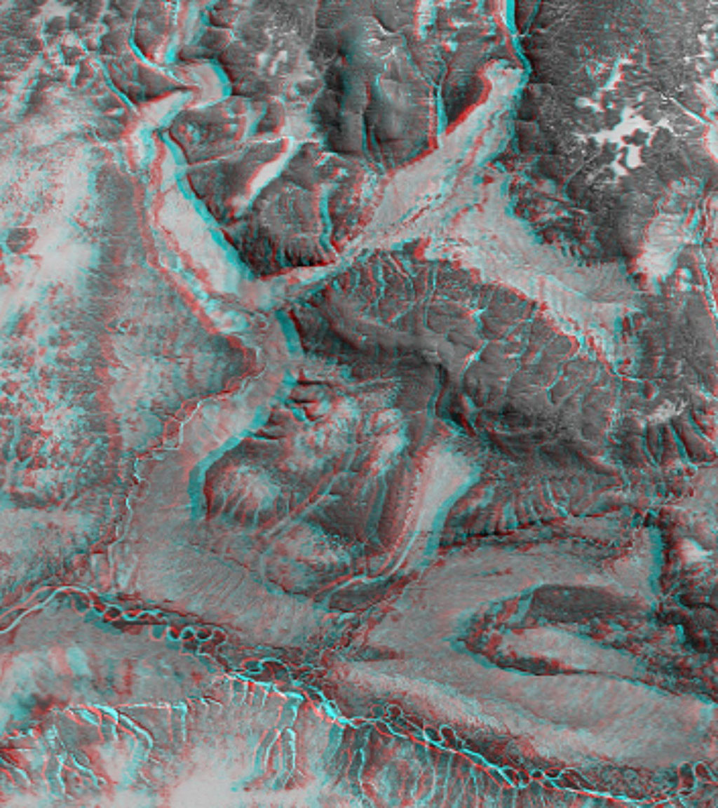 This 3-D anaglyph shows an area on the western side of the volcanically active Kamchatka Peninsula, Russia as seen by the instrument onboard NASA's Shuttle Radar Topography Mission. 3D glasses are necessary to view this image.