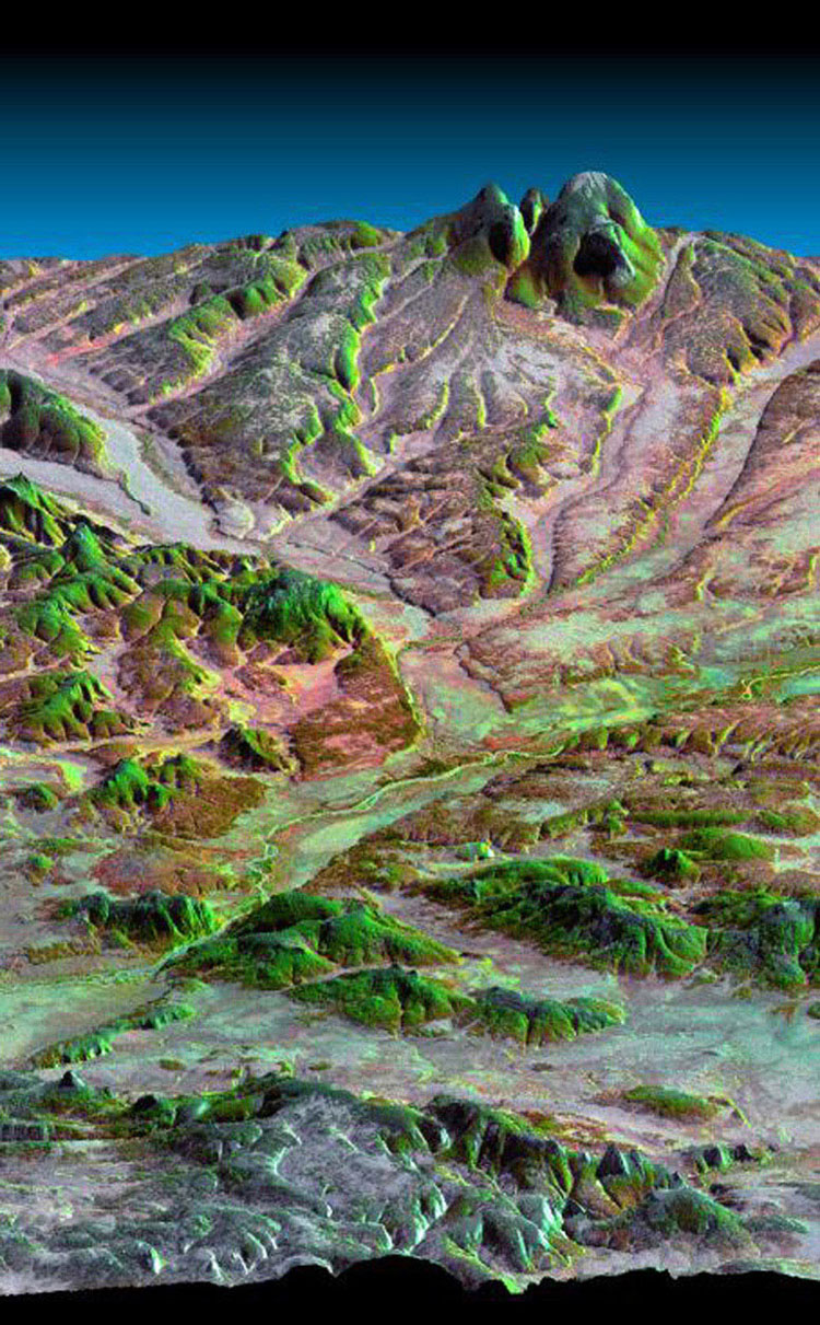 This three-dimensional perspective view, looking up the Tigil River, acquired by NASA's Shuttle Radar Topography Mission from data collected on February 16, 2000, shows the western side of the volcanically active Kamchatka Peninsula, Russia.
