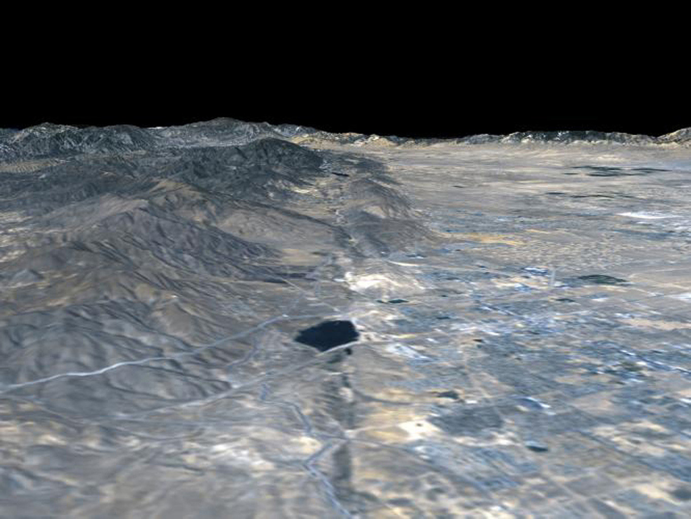 The prominent linear feature straight down the center of this perspective view from NASA's Shuttle Radar Topography Mission is the San Andreas Fault. This segment of the fault lies near the city of Palmdale, CA, about 60 kilometers north of Los Angeles.