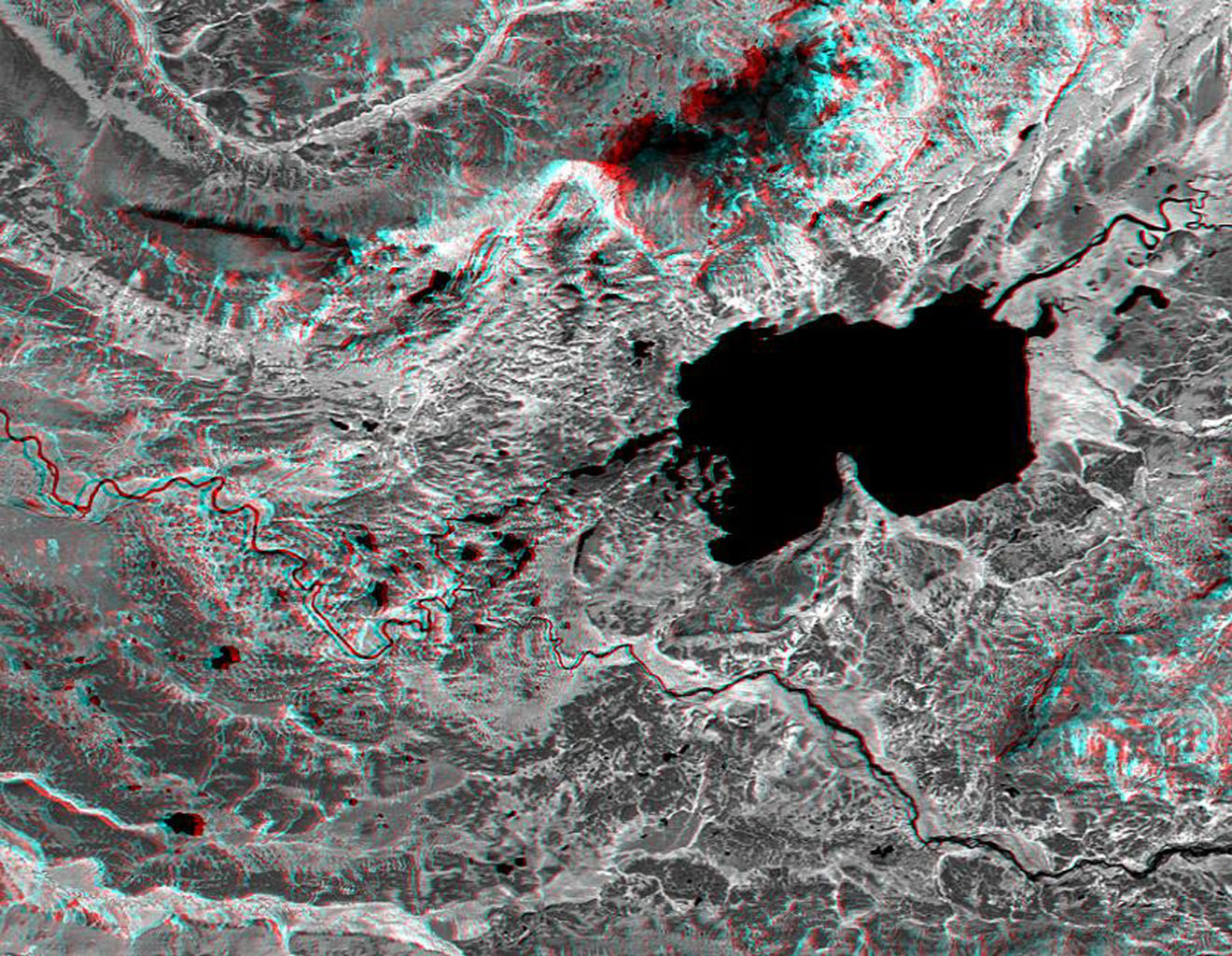 This anaglyph, from NASA's Shuttle Radar Topography Mission, is of Lake Palanskoye in northern Kamchatka. 3D glasses are necessary to view this image.