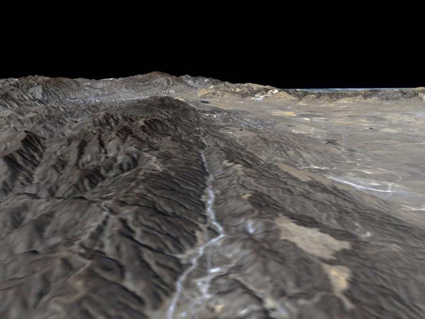 The prominent linear feature straight down the center of this perspective view is California's famous San Andreas Fault. The image was created with data from NASA's Shuttle Radar Topography Mission.