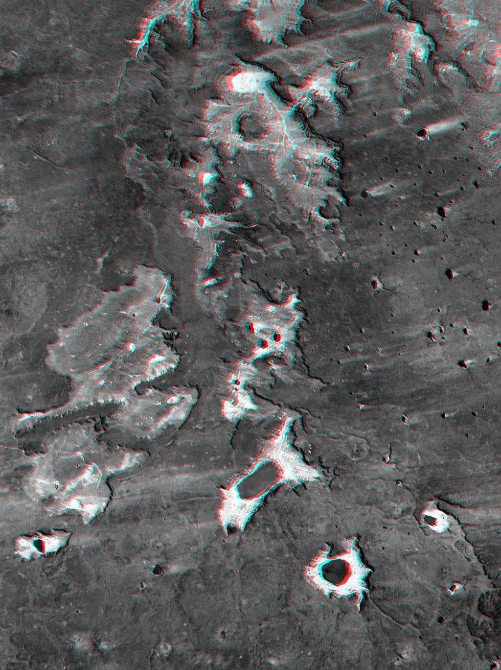 This anaglyph, from NASA's Shuttle Radar Topography Mission, shows Meseta de Somuncura, a semi-arid basalt plateau in northern Patagonia. 3D glasses are necessary to view this image.