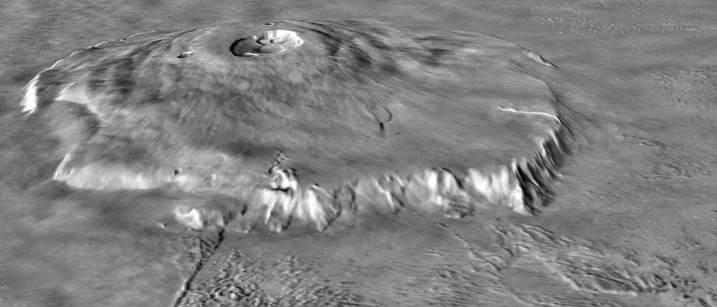 NASA's Mars Global Surveyor shows Olympus Mons on Mars featuring the volcano's scarp and massive aureole deposit that was produced by flank collapse.