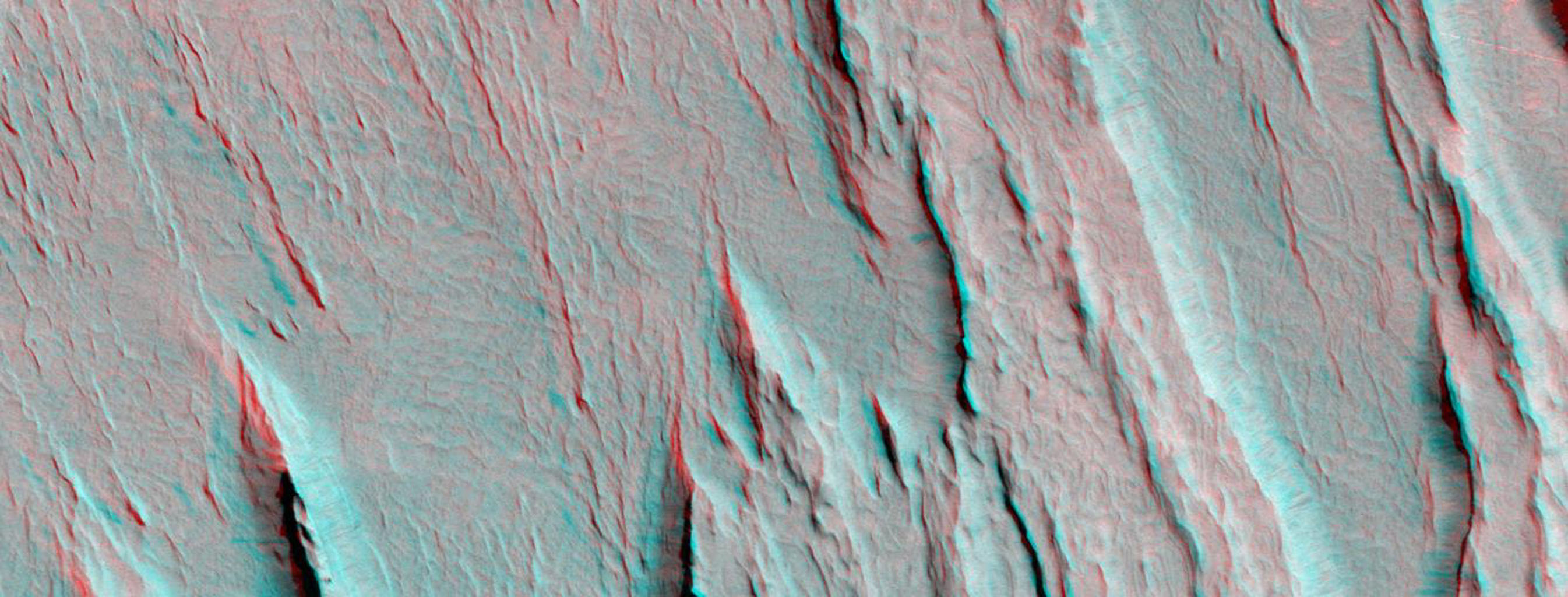 Layers of bedrock etched by wind to form sharp, elongated ridges known to geomorphologists as yardangs are commonplace in the southern Elysium Planitia/southern Amazonis region of Mars. 3D glasses are necessary to view this image.