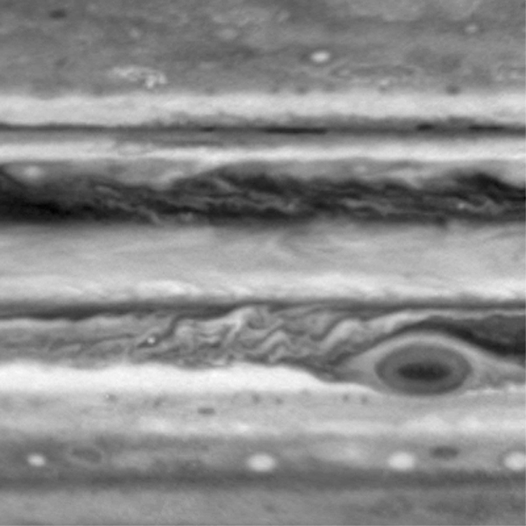 This frame from a movie shows counterclockwise atmospheric motion around Jupiter's Great Red Spot. Image taken by NASA's Cassini spacecraft during seven separate rotations of Jupiter between Oct. 1 and Oct. 5, 2000.