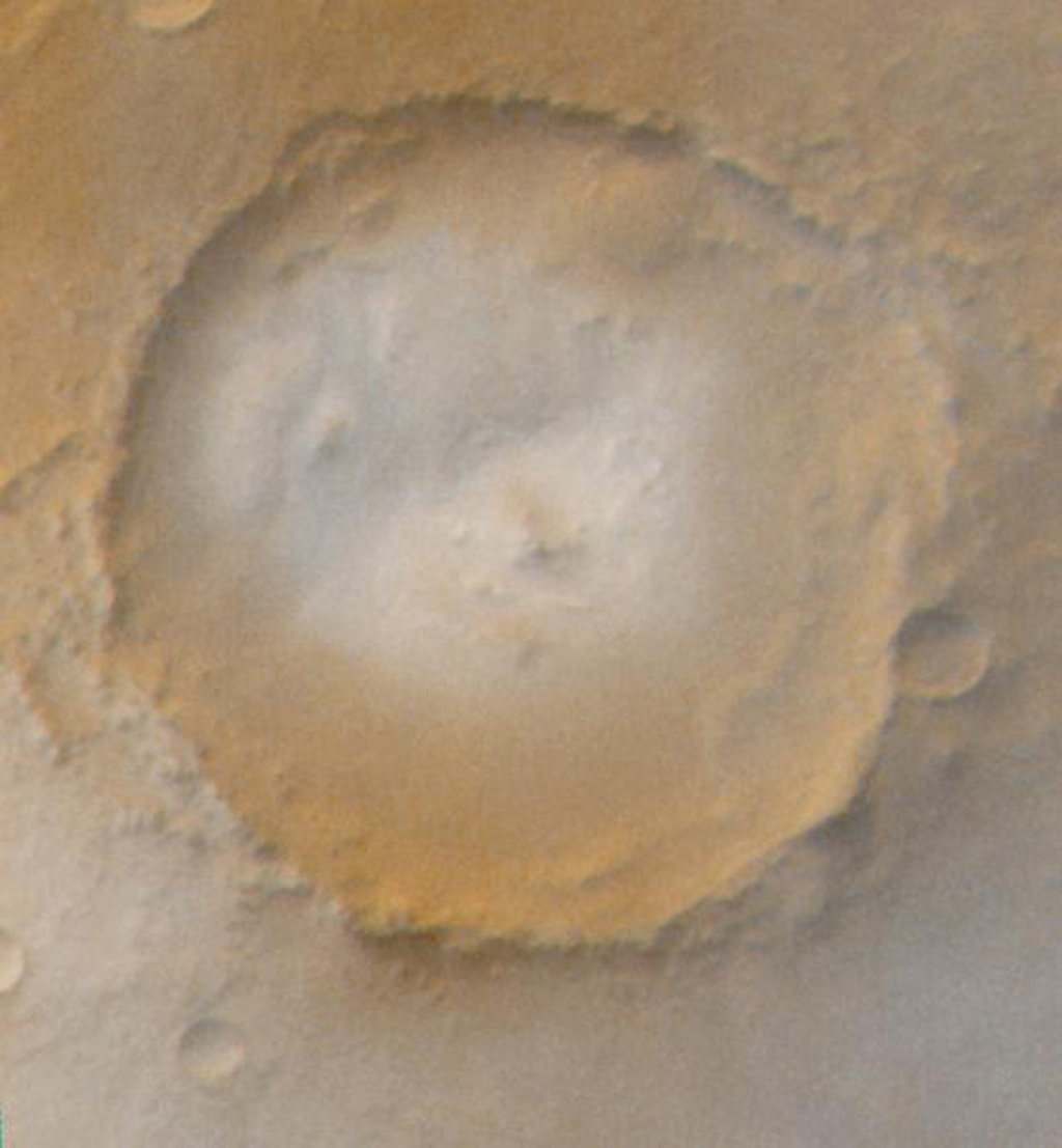 NASA's Mars Global Surveyor shows frosted craters of northern spring and southern autumn in an unnamed crater on Mars.