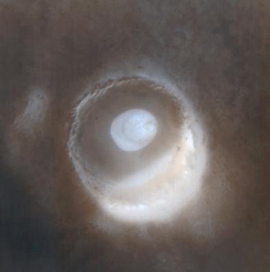 NASA's Mars Global Surveyor shows frosted craters of northern spring and southern autumn in Barnard Crater on Mars.