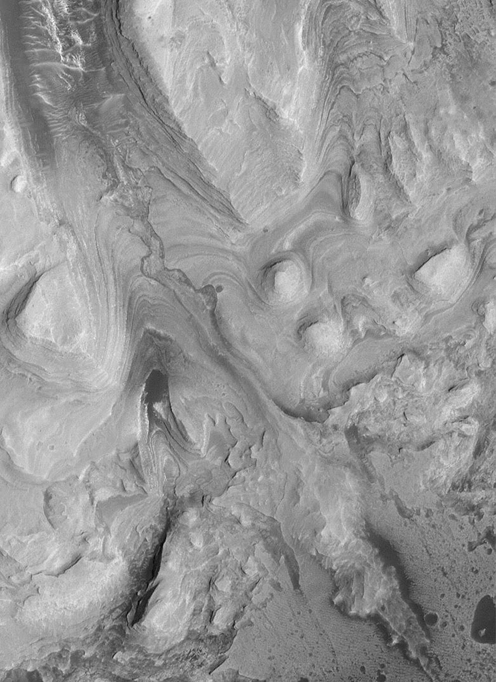 NASA's Mars Global Surveyor shows southwestern Candor Chasma on Mars. The most striking feature is the filled channel.