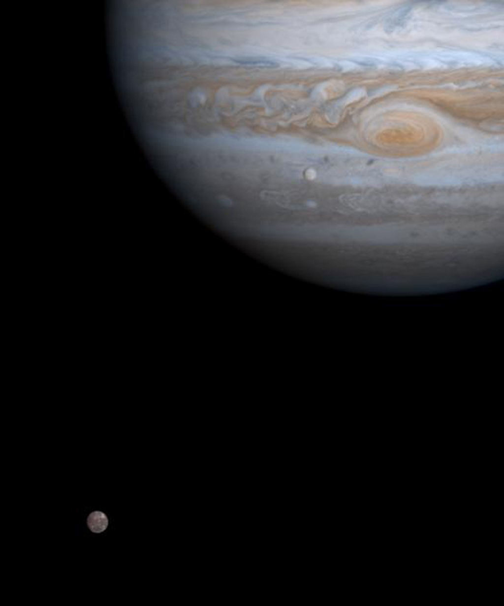 One moment in an ancient, orbital dance is caught in this color picture taken by NASA's Cassini spacecraft on Dec. 7, 2000, just as two of Jupiter's four major moons, Europa and Callisto, were nearly perfectly aligned with each other.