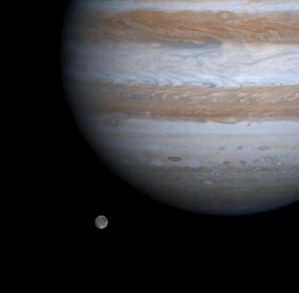 The solar system's largest moon, Ganymede, is captured here alongside the planet Jupiter in a color picture taken by NASA's Cassini spacecraft on Dec. 3, 2000.