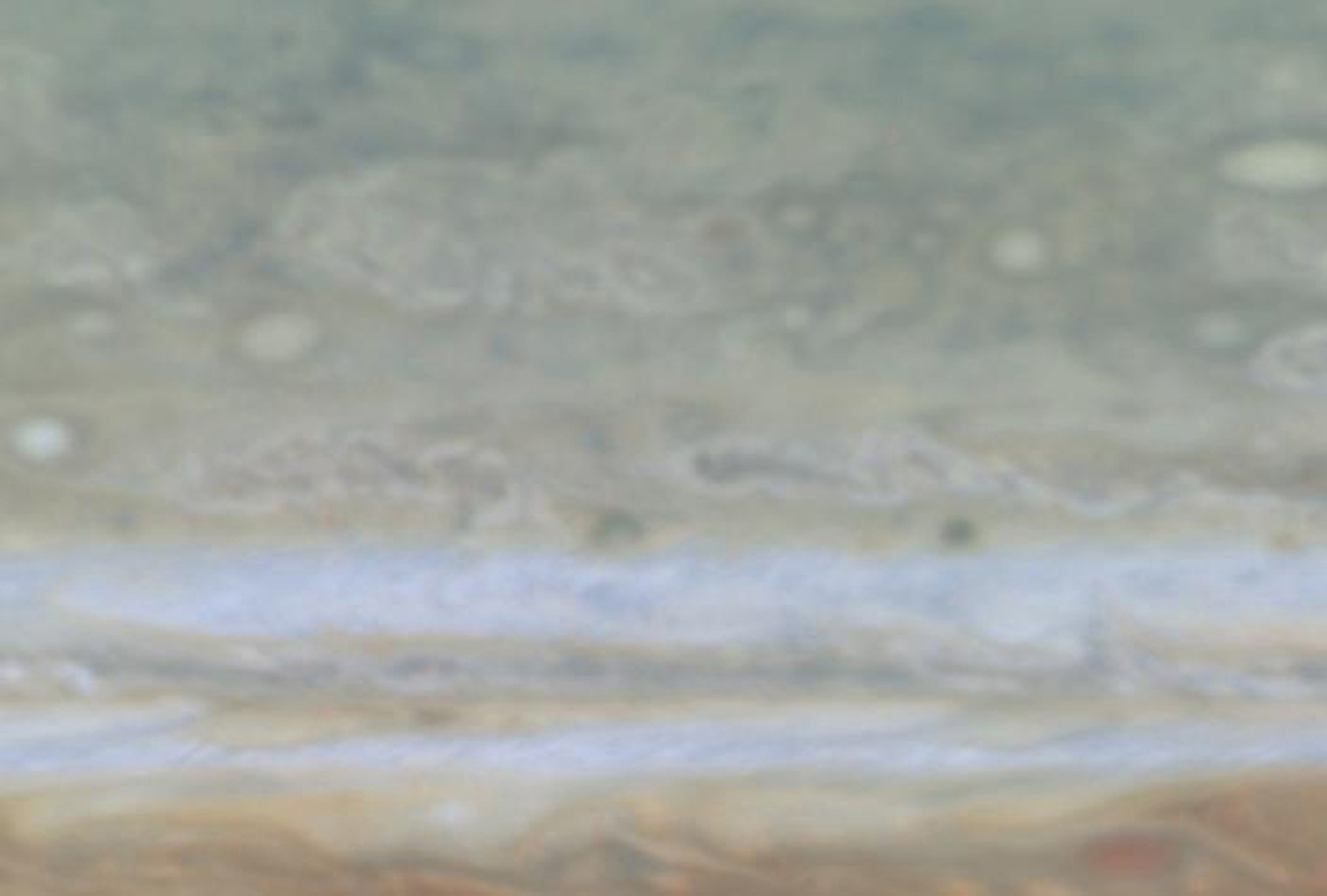 In this frame from a, created from images taken by NASA's Cassini spacecraft, shows a high-latitude area of Jupiter.