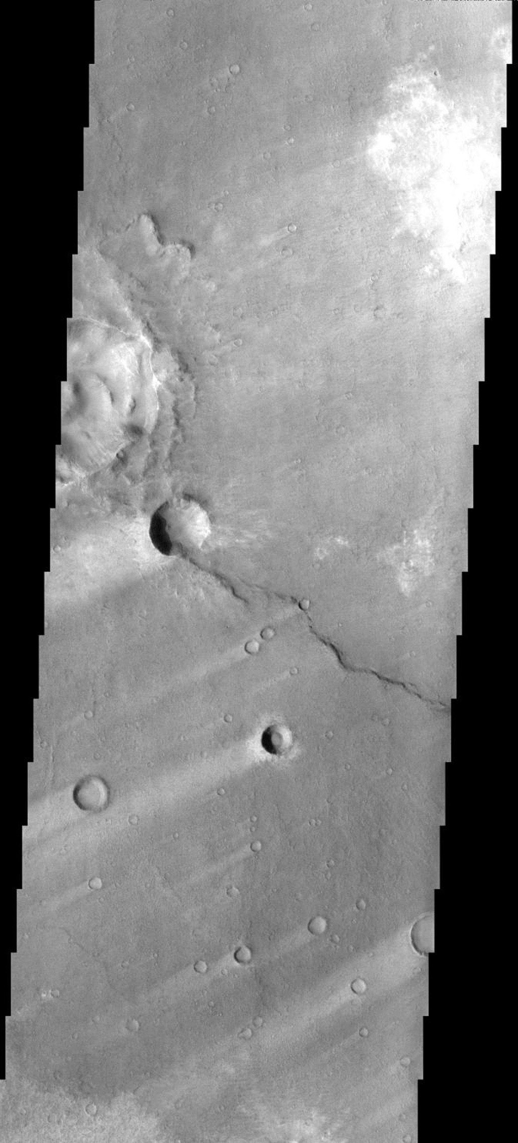 These windstreaks are located in the southern part of Syrtis major on Mars. This image was taken by NASA's 2001 Mars Odyssey.