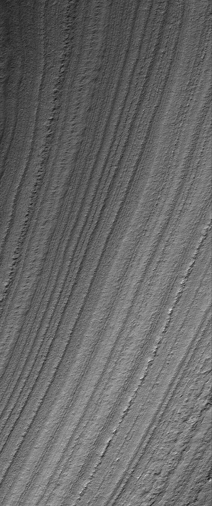 NASA's Mars Global Surveyor shows a mid-summer view of layered terrain in the south polar region of Mars.