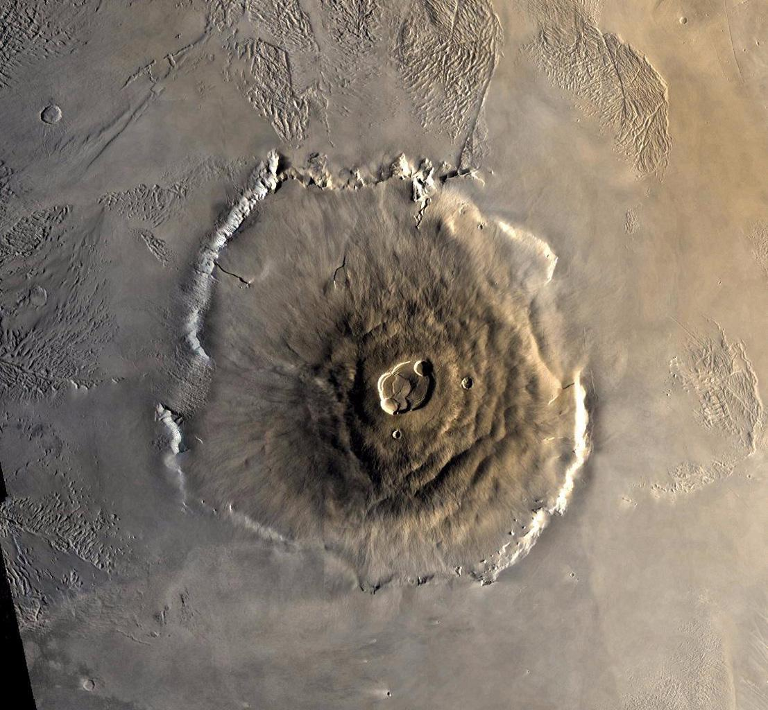 Color mosaic of Olympus Mons volcano on Mars from NASA's Viking 1 Orbiter. The mosaic was created using images from orbit 735 taken 22 June 1978. Olympus Mons is about 600 km in diameter and the summit caldera is 24 km above the surrounding plains.
