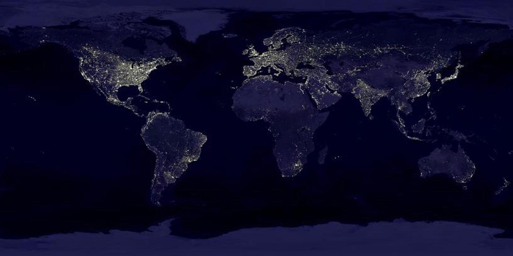 The Eastern U.S., Europe, and Japan are brightly lit by their cities, while interiors of Africa, Asia, Australia, and South America are dark and lightly populated in this image created in 2000 by NASA's Goddard Space Flight Center.