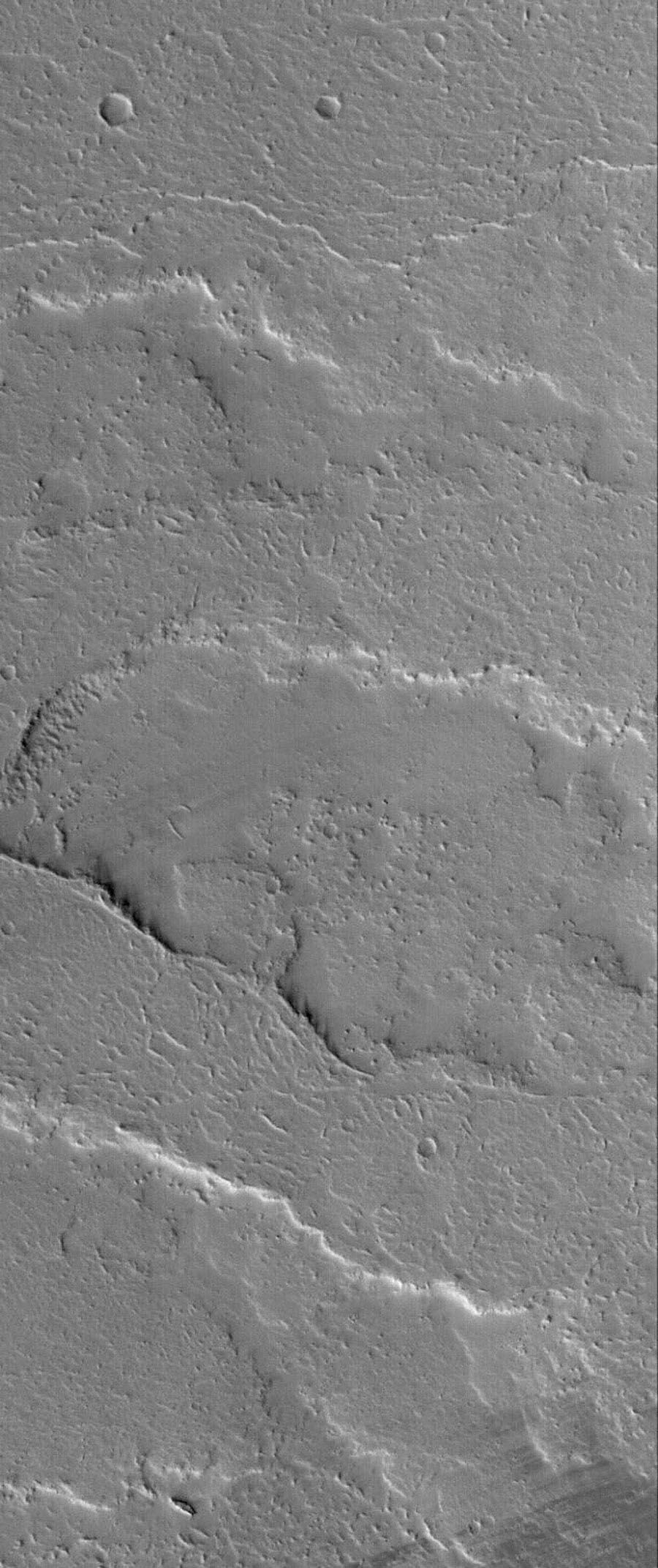 NASA's Mars Global Surveyor shows several overlapping lava flows located on the vast plains east of the volcano, Ascraeus Mons on Mars. Hundreds of lava flows cover the plains from Ascraeus Mons eastward to Kasei Valles.