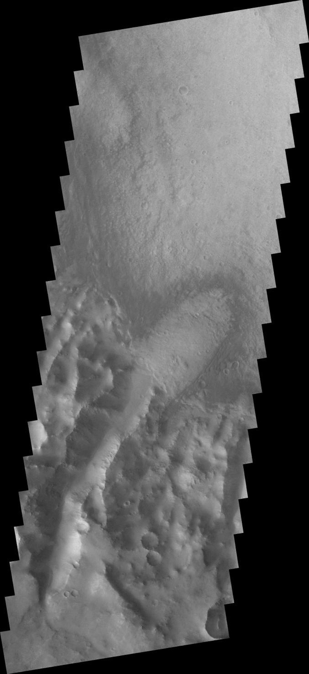 This image from NASA's 2001 Mars Odyssey spacecraft shows a large portion of etched terrain near the south pole of Mars.