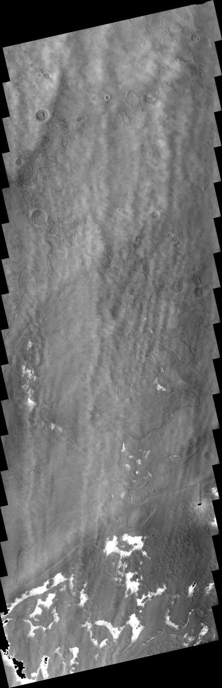 This image from NASA's 2001 Mars Odyssey spacecraft shows a system of clouds just off the margin of the South Polar cap on Mars. Taken during the summer season, these clouds contain both water-ice and dust.