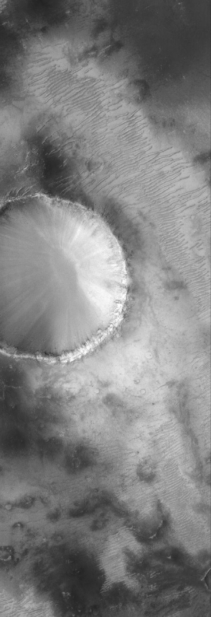 NASA's Mars Global Surveyor shows a portion of an old impact crater in the Sinus Sabaeus region of Mars, just south of the large impact basin, Schiaparelli.