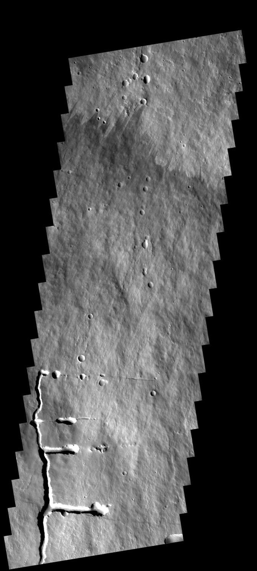 This image shows a portion of the flank of Pavonis Mons on Mars as seen by NASA's 2001 Mars Odyssey spacecraft. The collapse features at the bottom of the image are related to subsurface tubes that once contained lava.