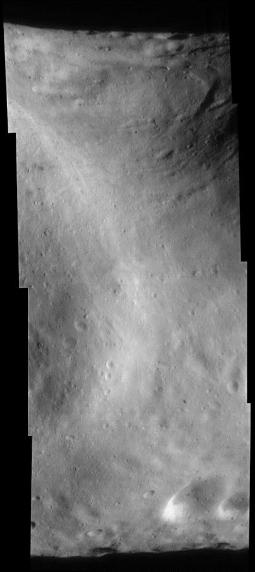 This image of asteroid Eros, taken by NASA's NEAR Shoemaker on Sept. 9, 2000, shows Eros' saddle, and curving around at upper right is the large bright-and-dark groove.