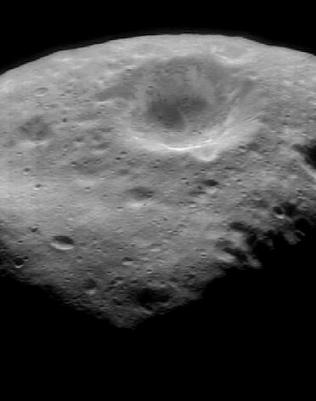 This image of asteroid Eros taken on Oct. 30, 2000, by NASA's NEAR Shoemaker shows brightness features on the crater's wall that are characteristic of most of the larger craters on Eros.