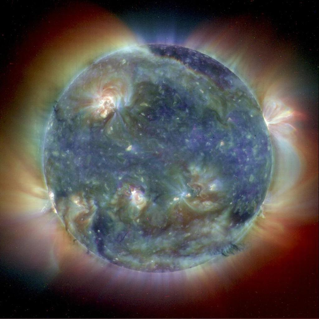 This composite image combines NASA's Extreme Ultravoilet Imaging Telescope images from three wavelengths into one that reveals solar features unique to each wavelength.