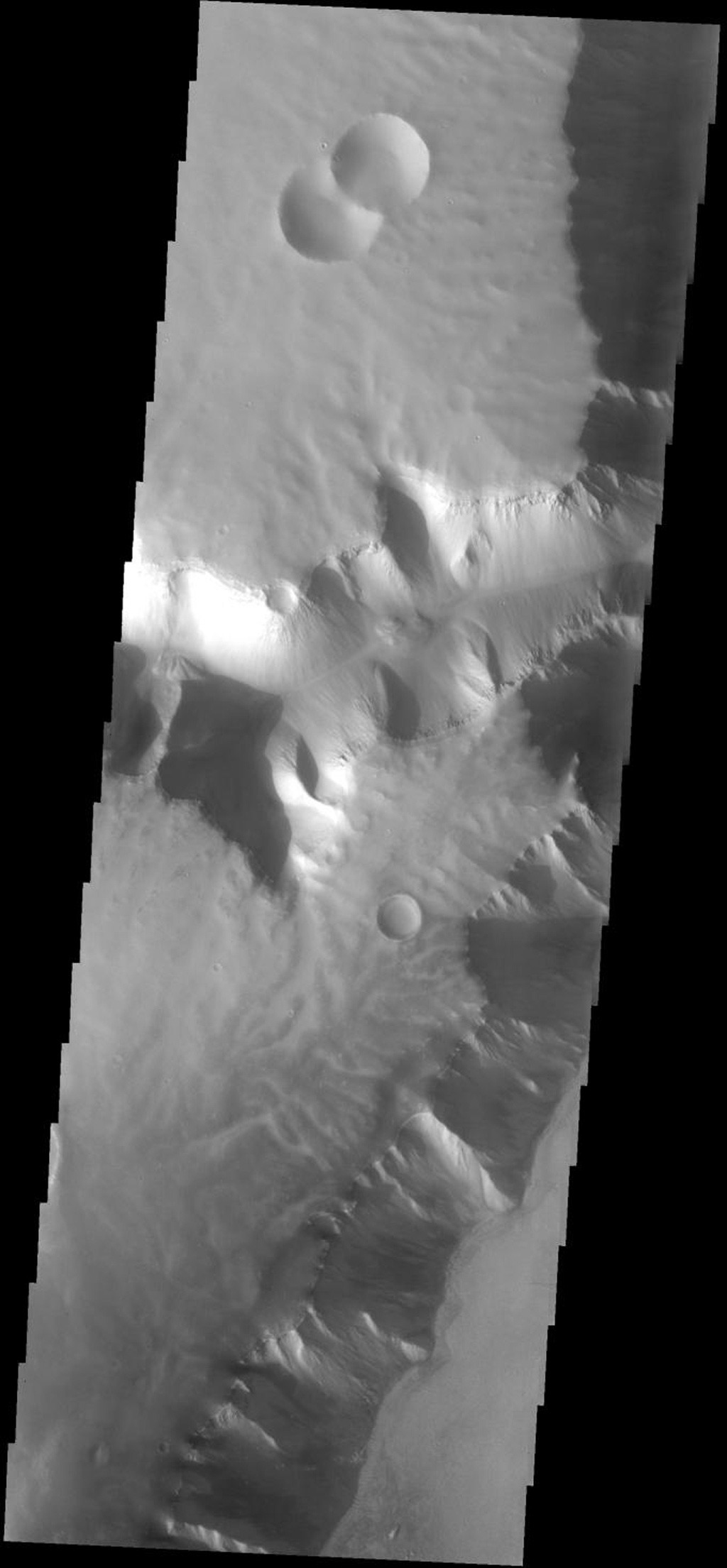 This plateau borders Echus Chasma on Mars. The surface of the plateau has been dissected by shallow channels of unknown origin. This image is from NASA's 2001 Mars Odyssey spacecraft.